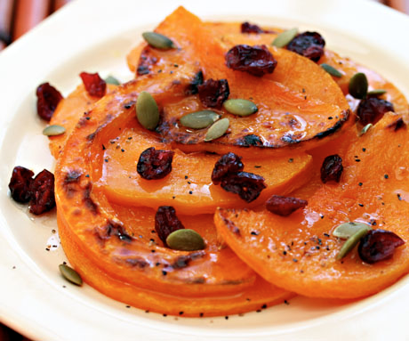 Roasted winter squash with cranberries, pepitas, and honey-lime vinaigrette.