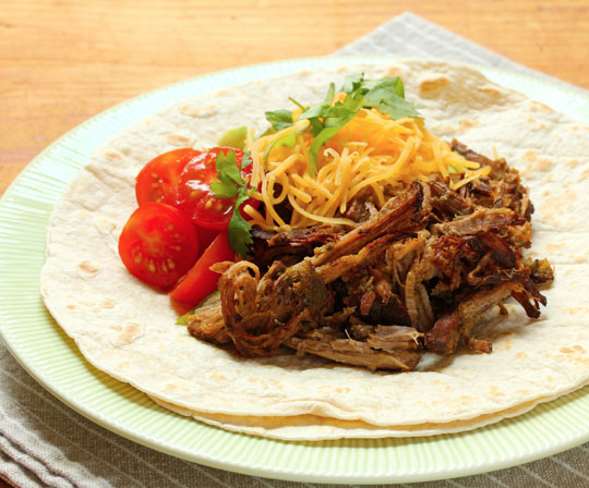 Make these shredded spicy and crispy beef carnitas at home, in your slow cooker.