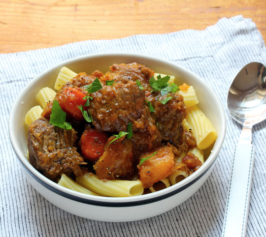 Slow cooker sweet and sour beef stew with carrots and squash, perfect for a chilly winter supper.